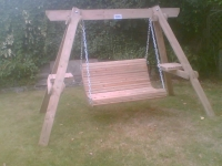 Custom built wooden garden swinging seat.