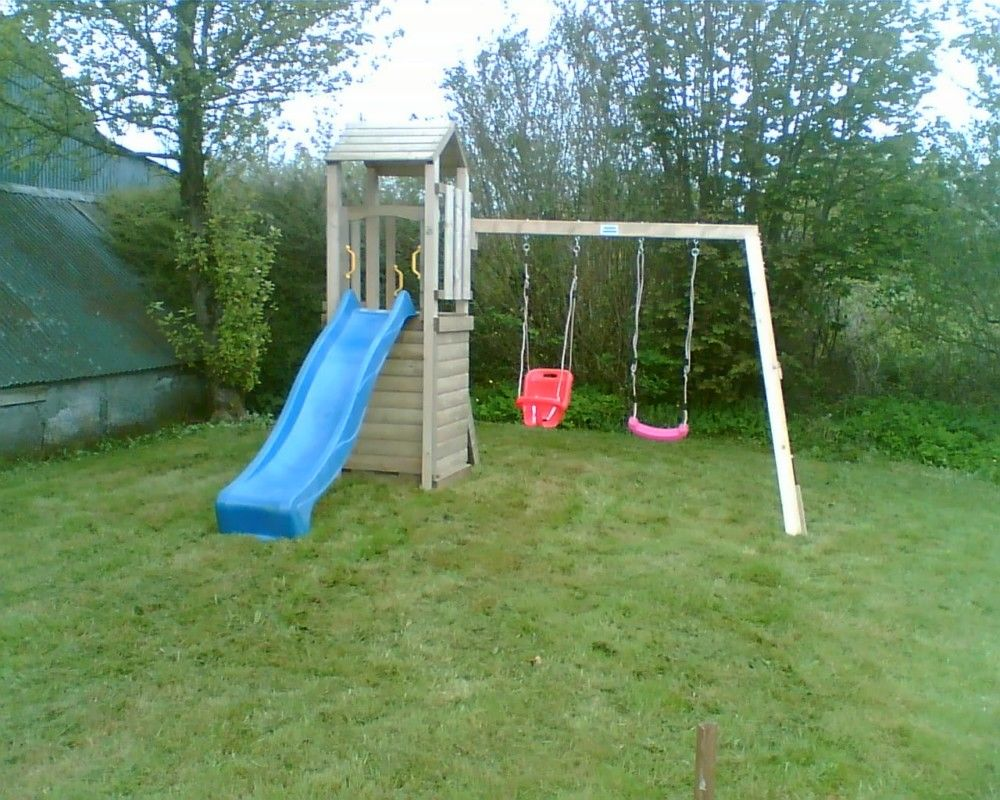 Custom made wooden play frame. Wooden garden climbing frame comes complete with different sizes of slide, and different types of swings in a wide range of colours. The garden climbing frame is designed for private use.